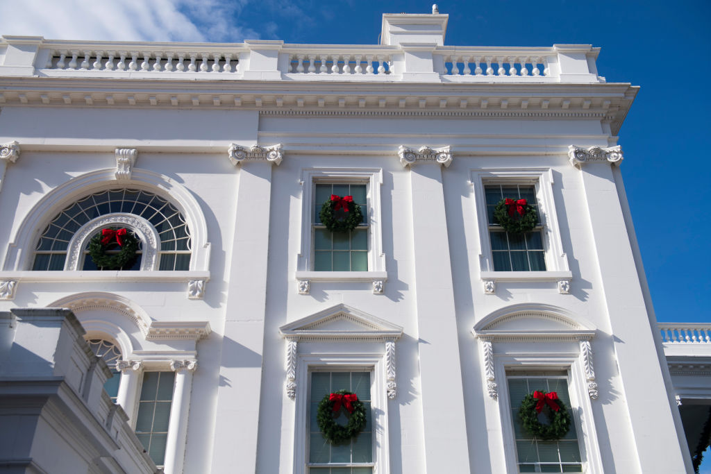 Christmas wreaths hang from the windows