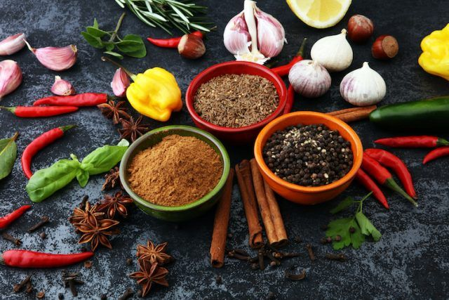 Vegetables and spices on a gray table.