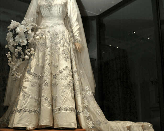 The queen's wedding gown on a mannequin.
