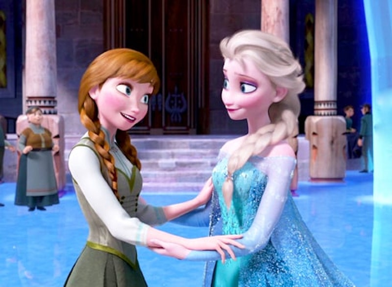 Anna and Elsa hold hands in Frozen