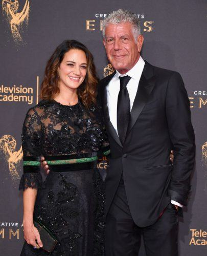 Actor Asia Argento and Anthony Bourdain on a red carpet.