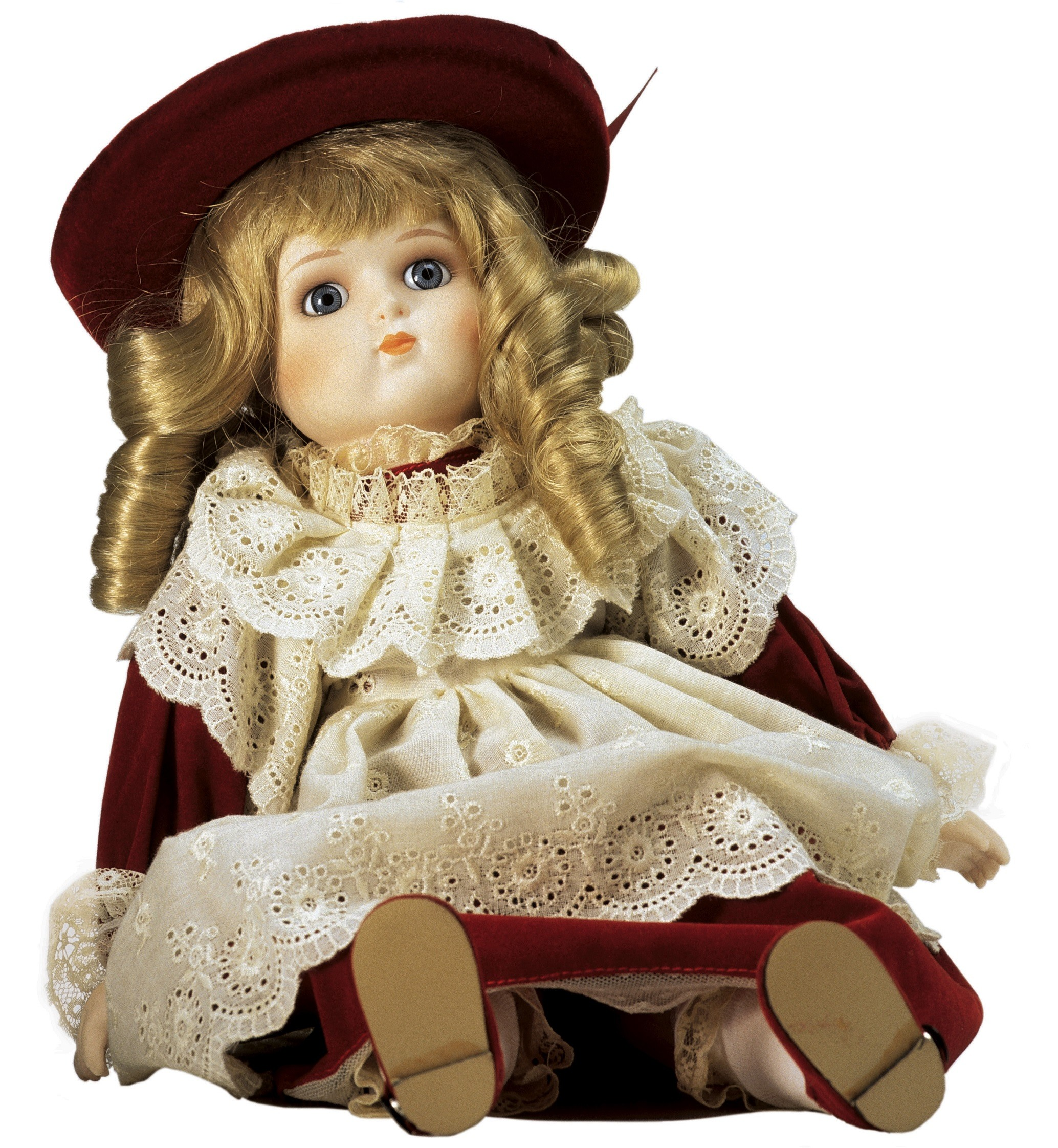 Porcelaine doll in red dress