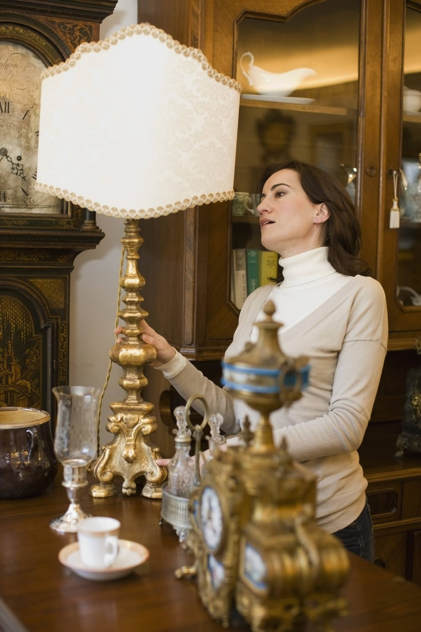 woman looking at antique lamps