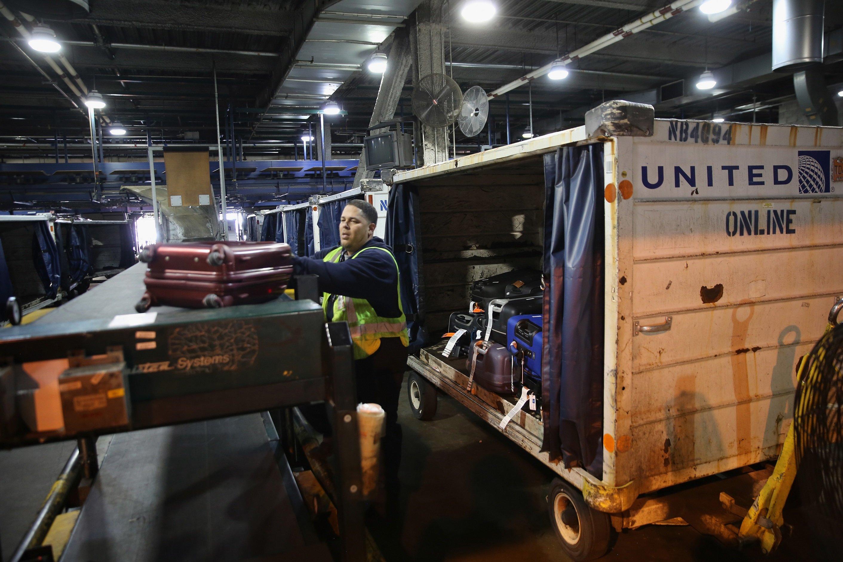 Baggage Handler loading luggage