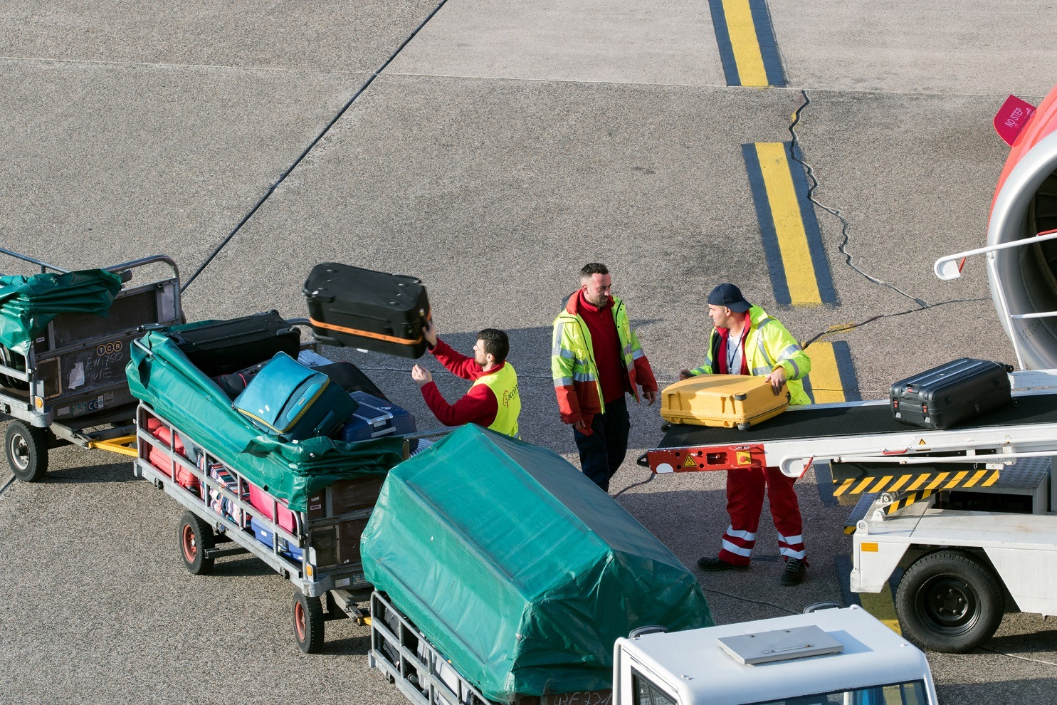 Baggage Handler loading luggage