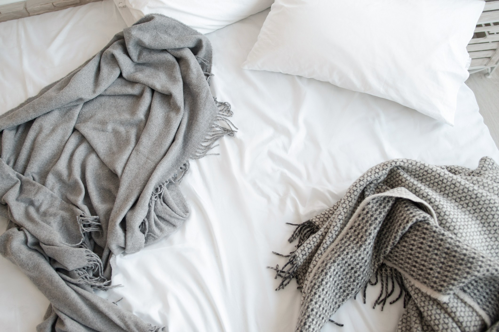 Unmade bed with blankets