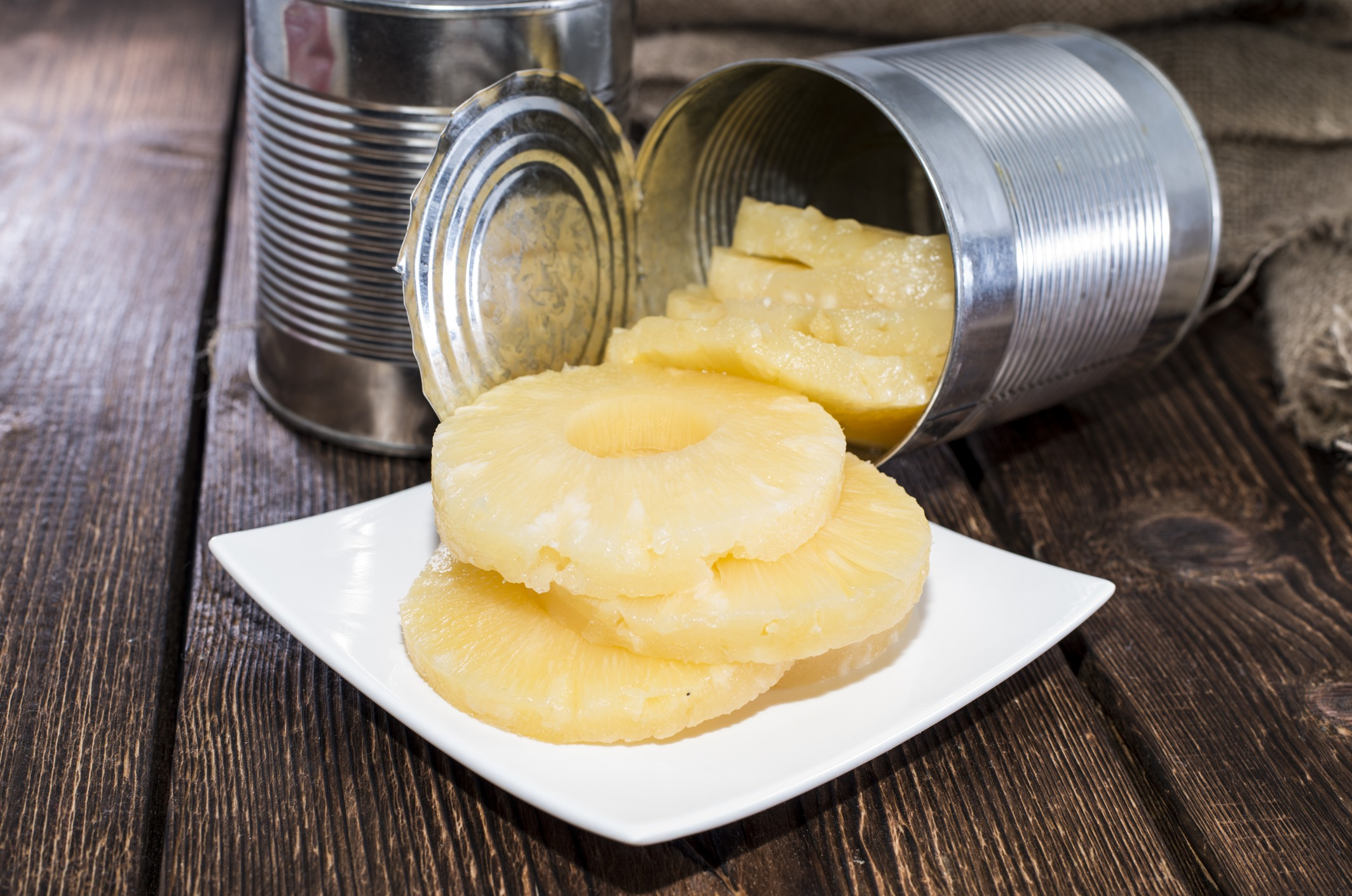 Canned Pineapple on wood