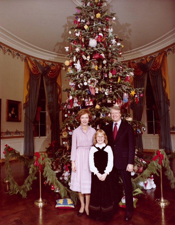 the carter family in front of their christmas tree