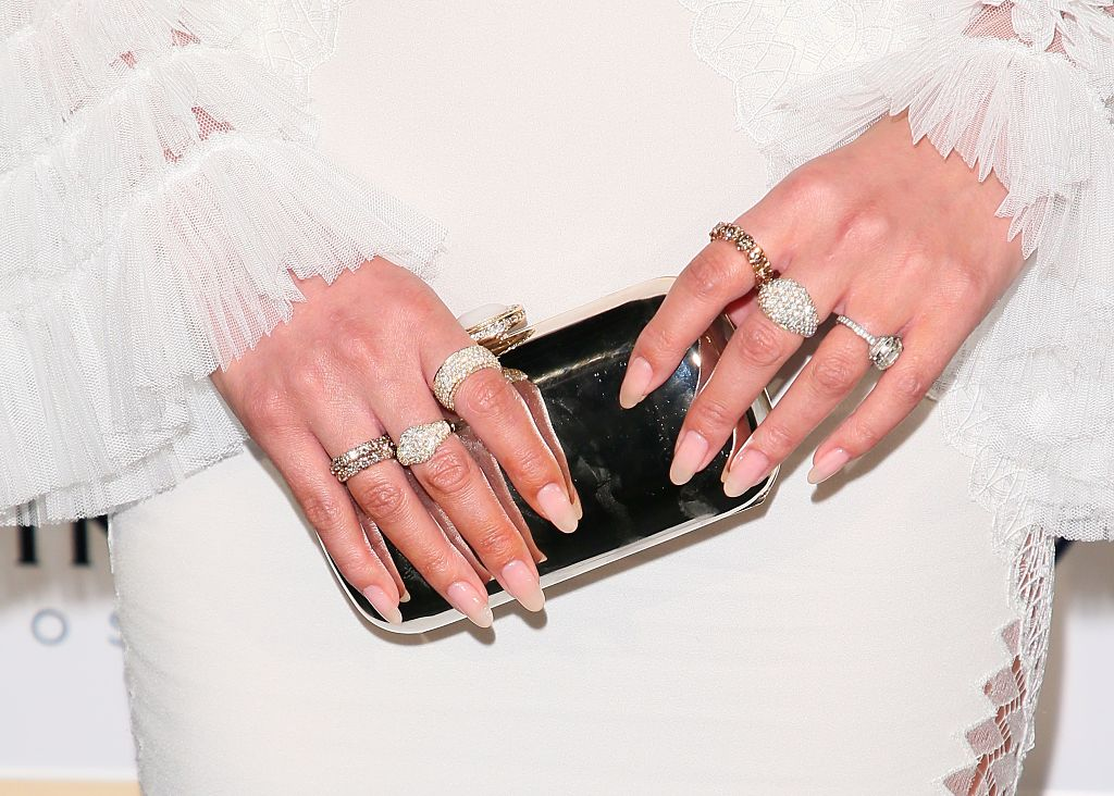 Chrissy Teigen nails and rings