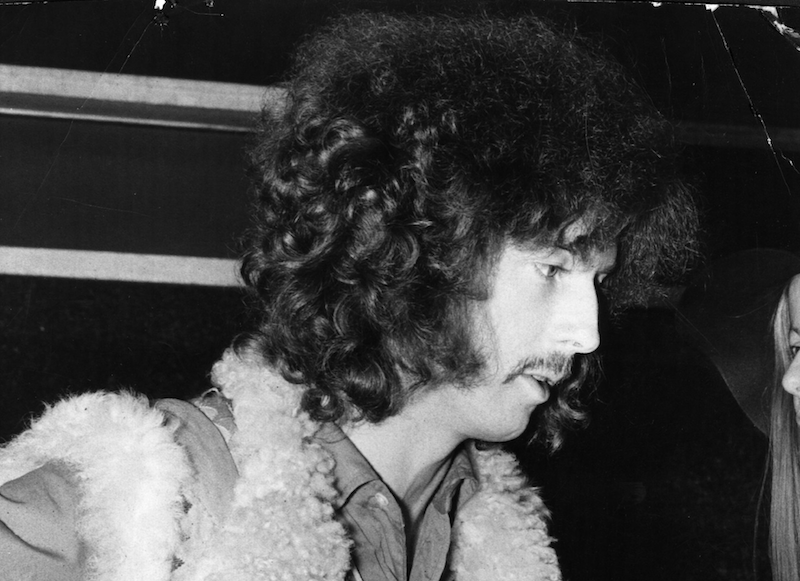 A black and white close up of Eric Clapton