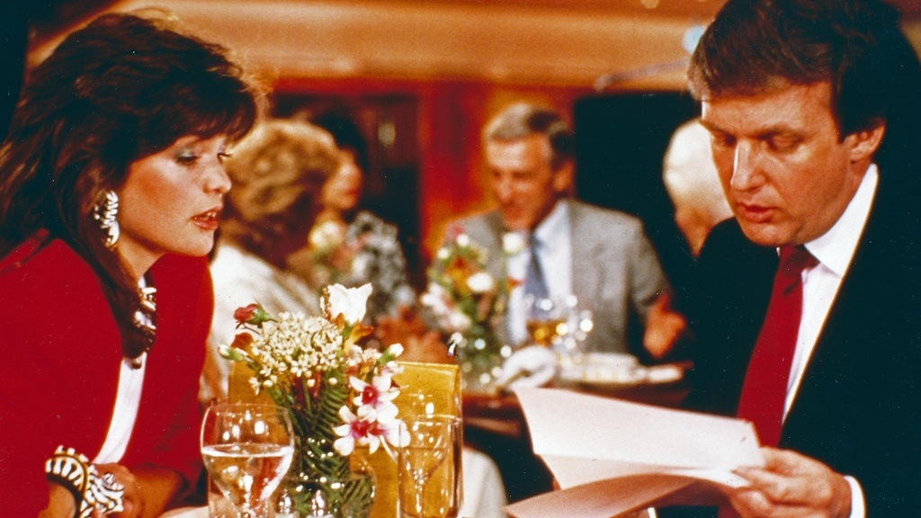 Donald Trump and Valerie Bertinelli sit at a table in I'll Take Manhattan