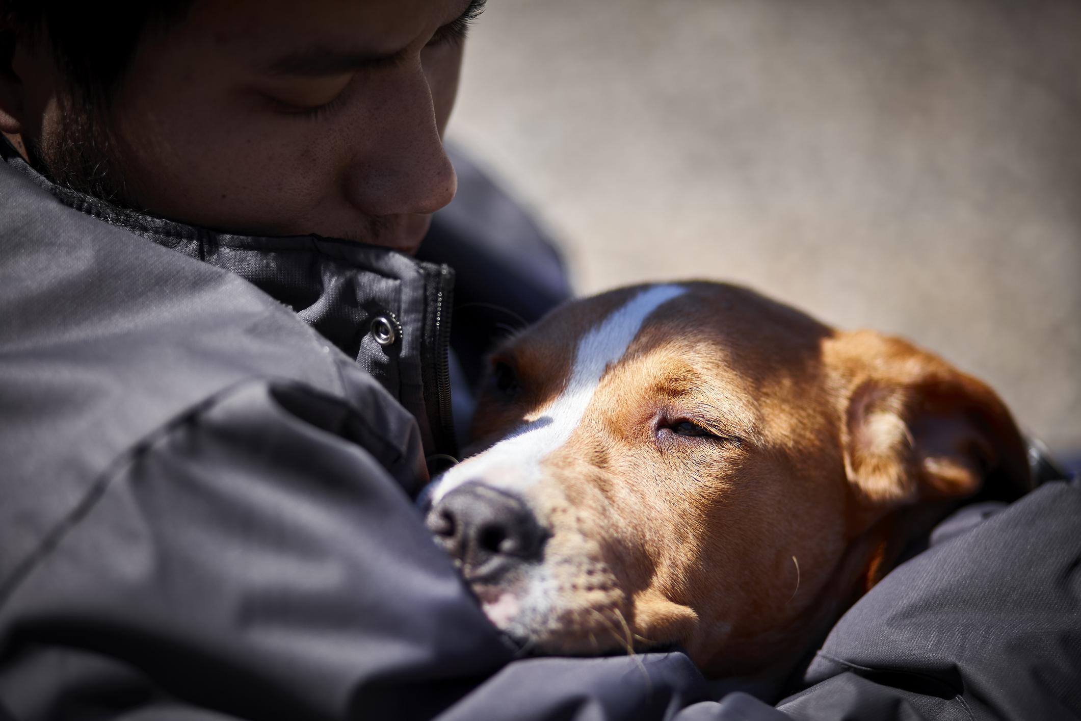 Man holding dog