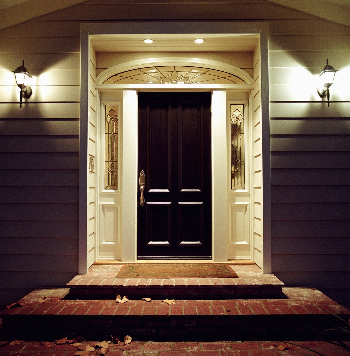 Front door of house with lights at night