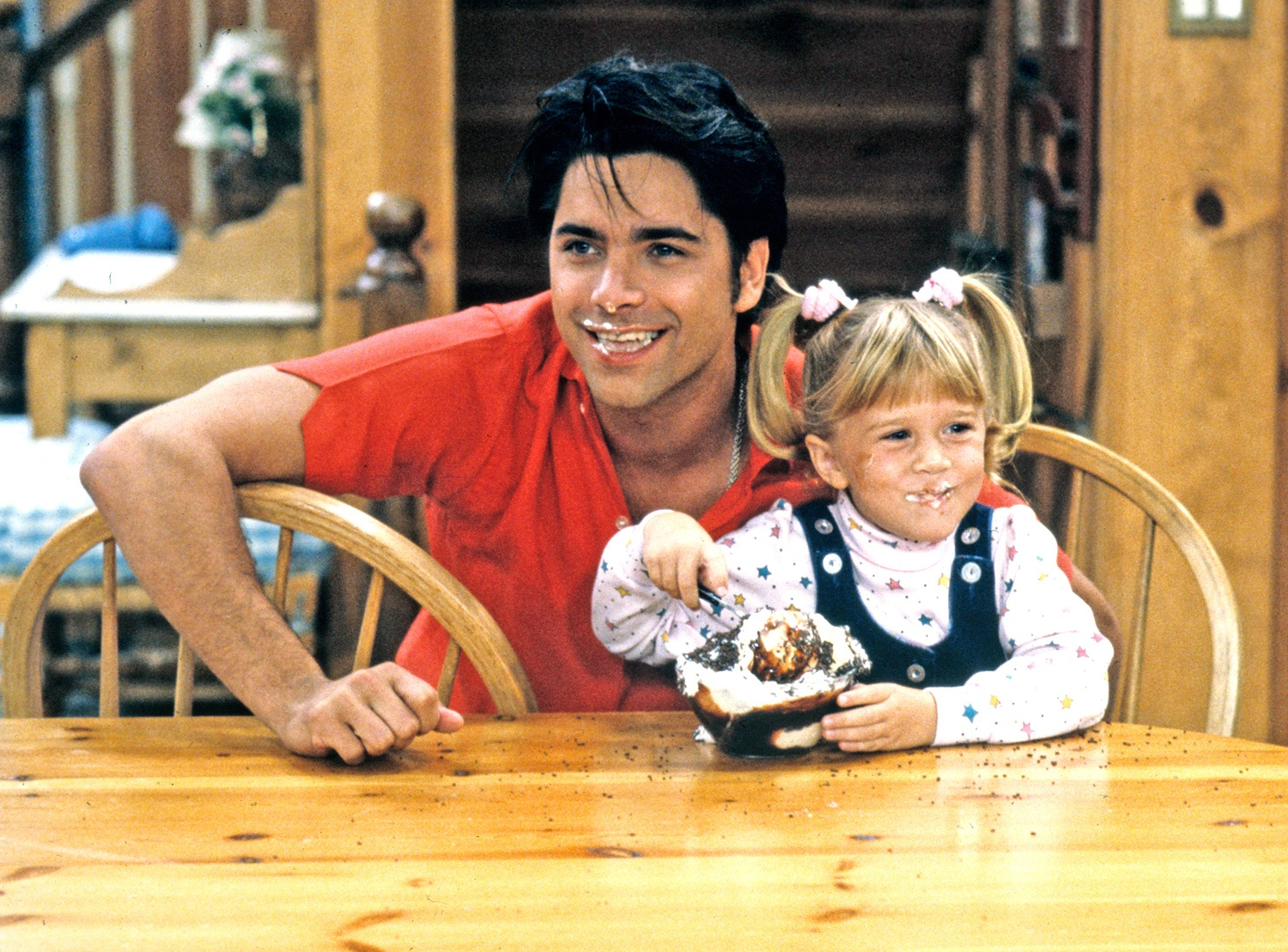 John Stamos with an Olsen twin on Full House