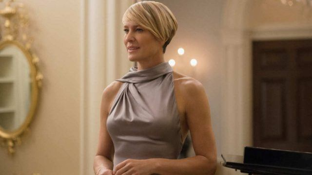 Robin Wright stands in a purple dress in 'House of Cards'.