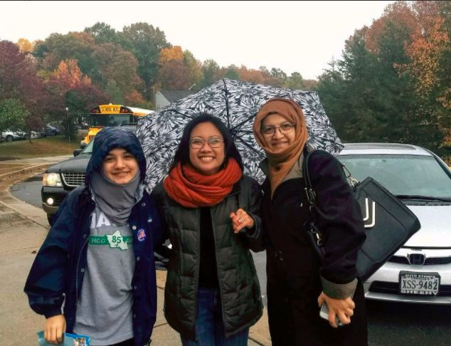 kathy tran posing with two constituents in hijabs