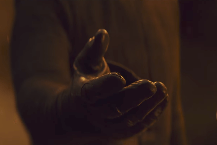 Kylo Ren extends his hand in Star Wars: The Last Jedi