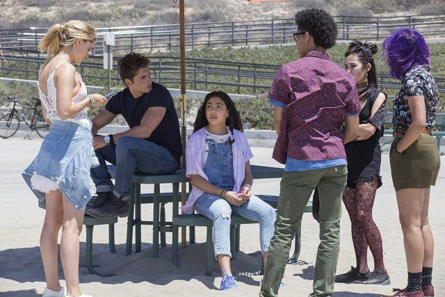 Marvel's Runaways characters joined together on a playground.