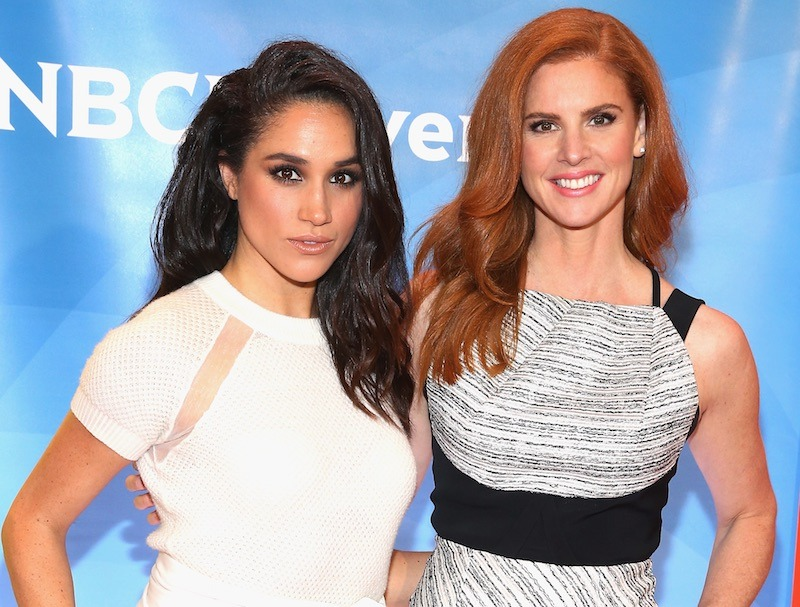 Meghan Markle and Sarah Rafferty stand next to each other