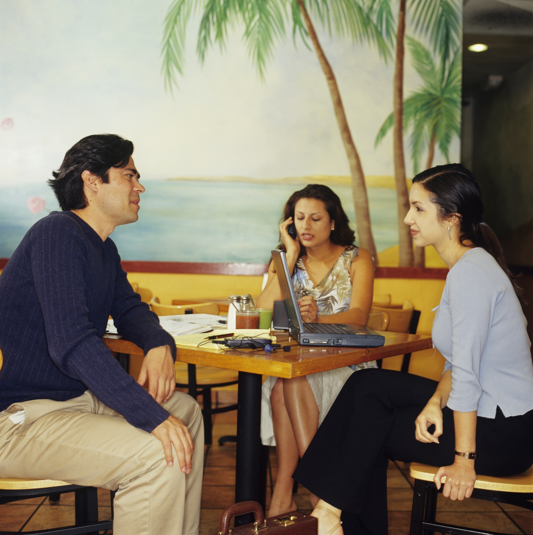 Three entrepreneurs dining at Mexican restaurant