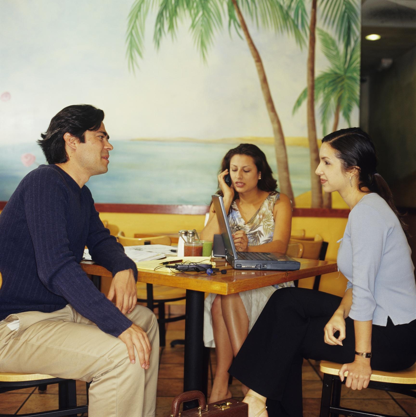 Three entrepreneurs dining at Mexican restaurant