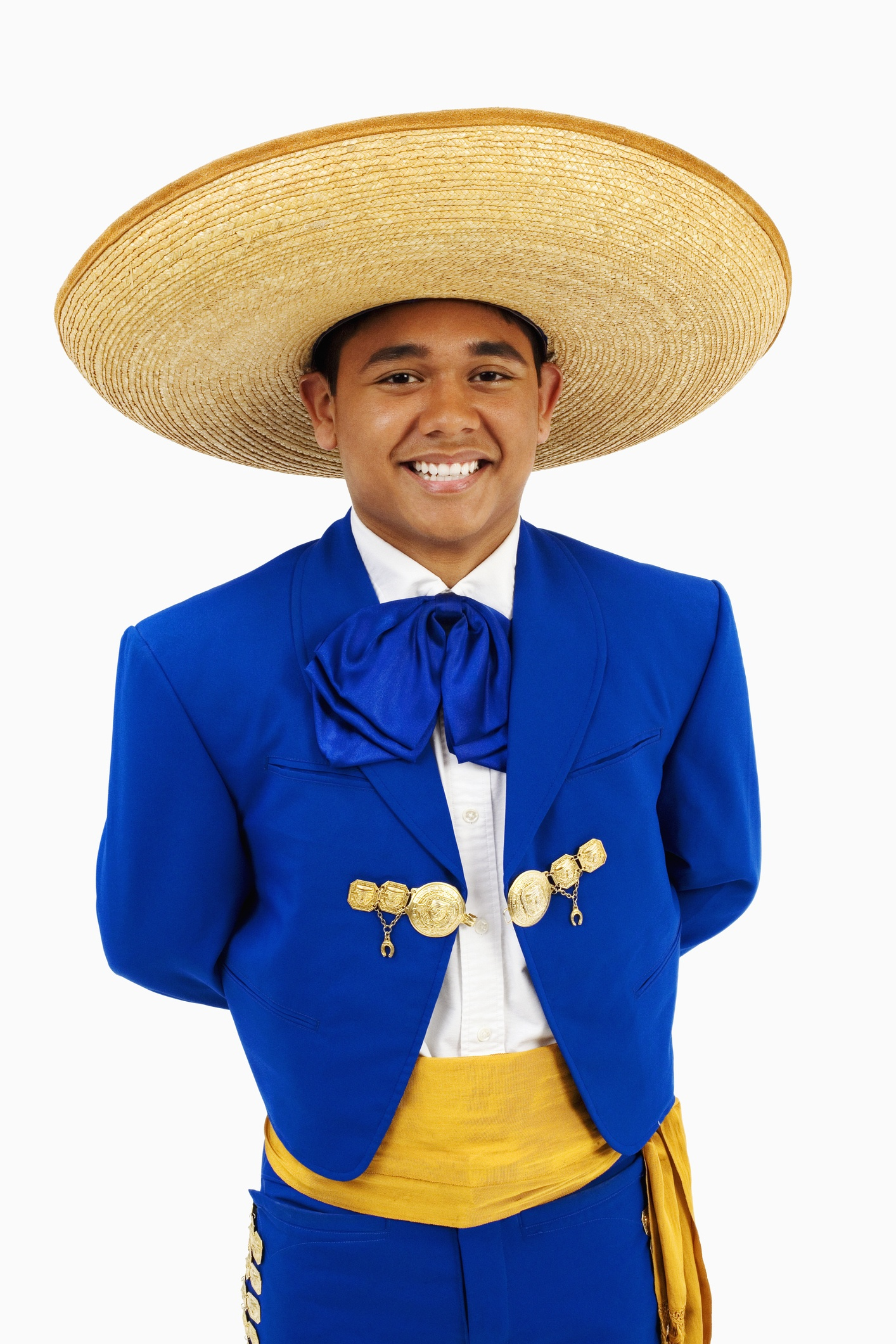 Young man in sombrero with hands behind back, portrait