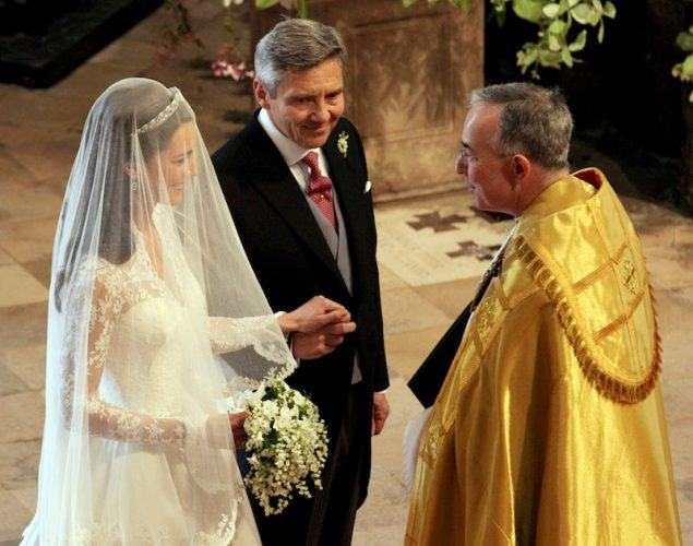 Kate Middleton holding a bouquet at the altar.