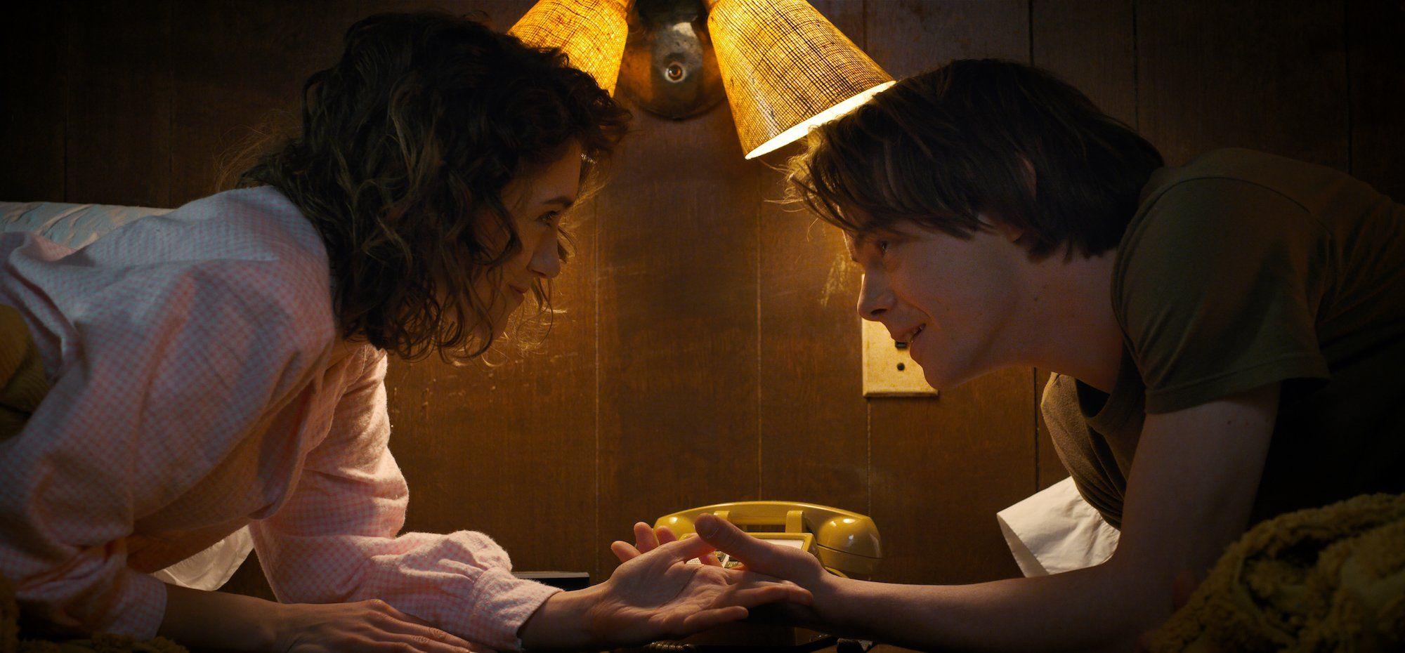 Natalia Dyer as Nancy Wheeler and Charlie Heaton as Jonathan Byers on Stranger Things 2
