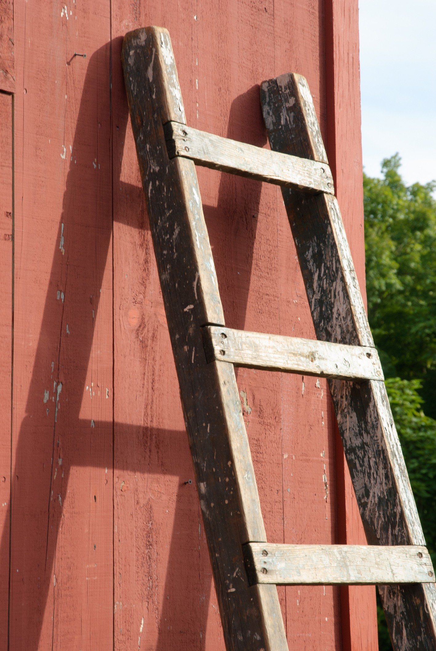 Wooden ladder against wall