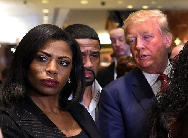 Omarosa Manigault and President Trump standing next to each other in a crowd.