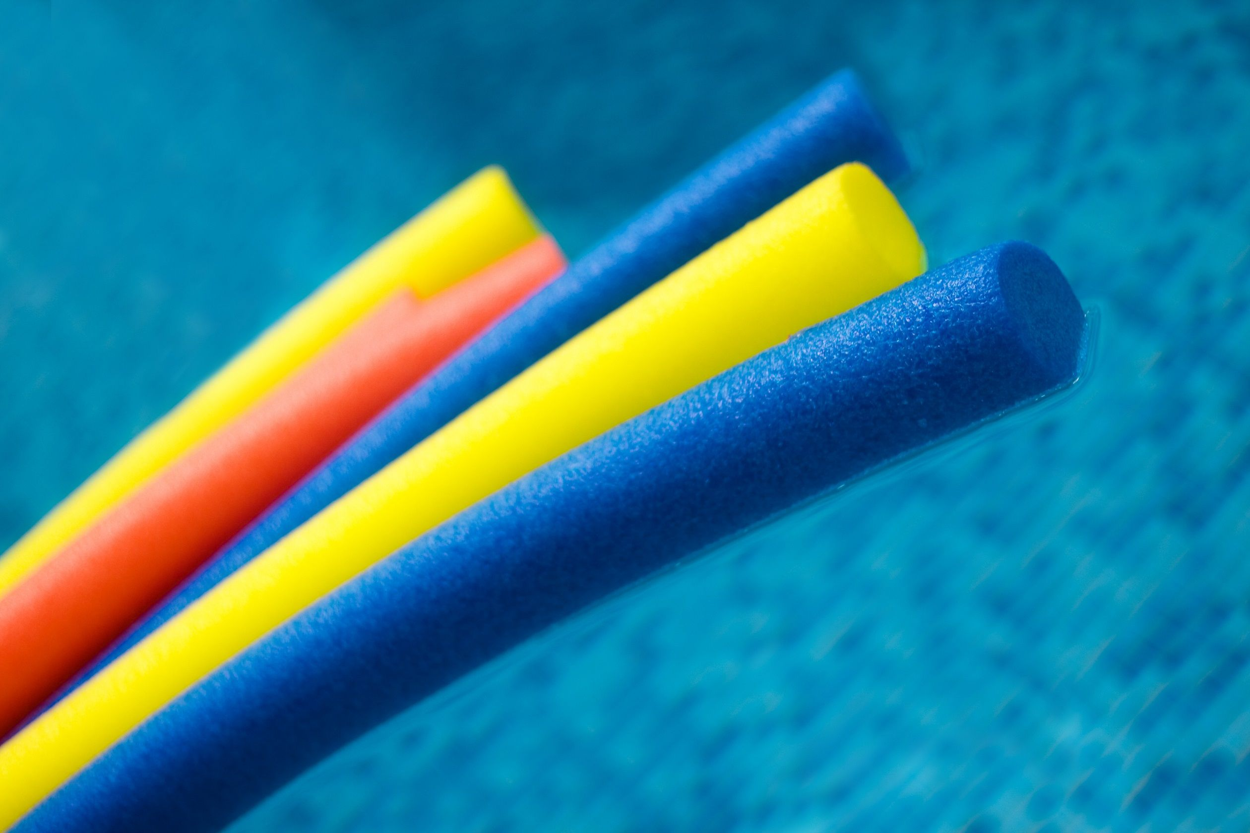 Pool noodles in water
