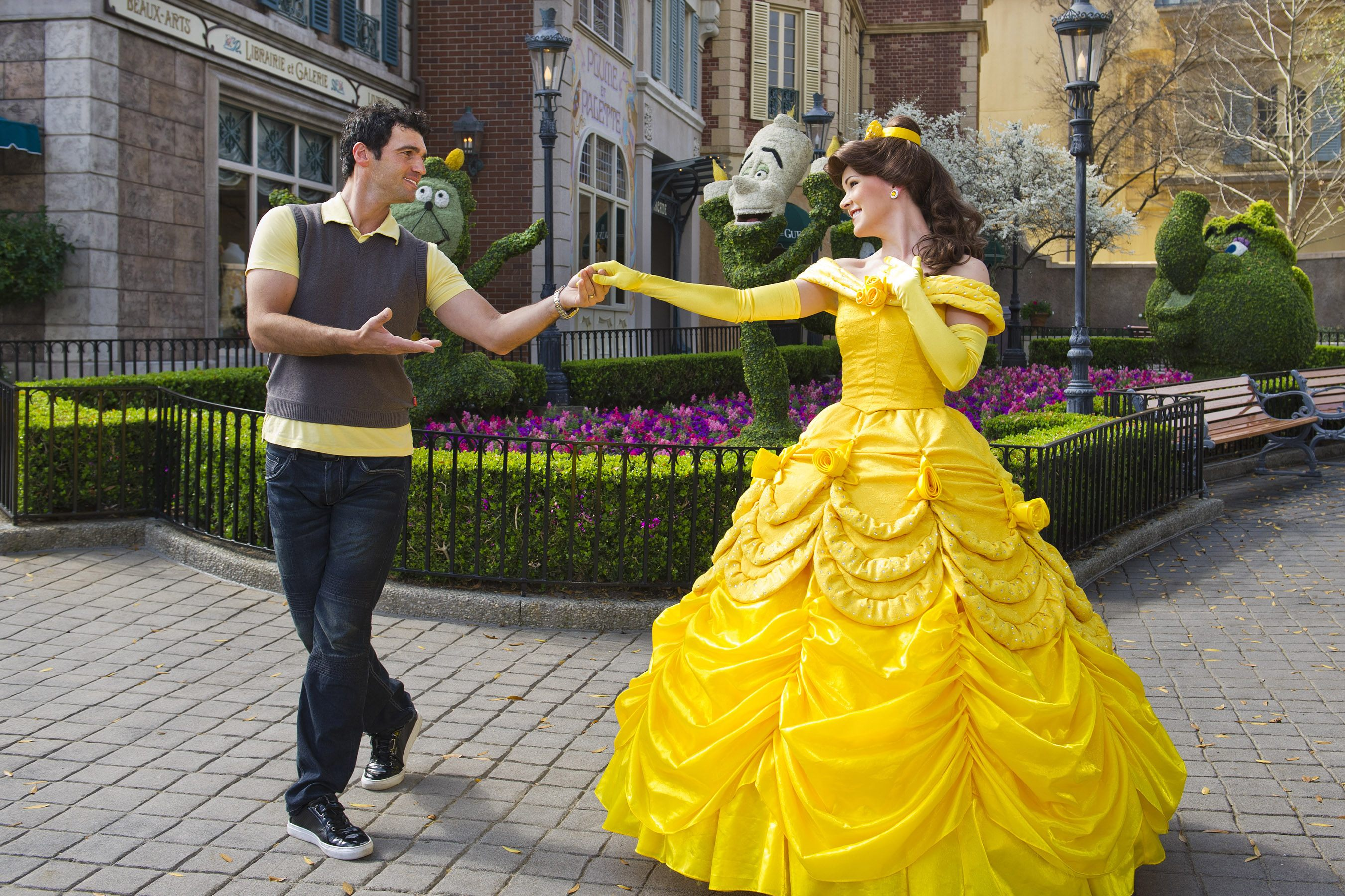 belle and a man dancing in disney