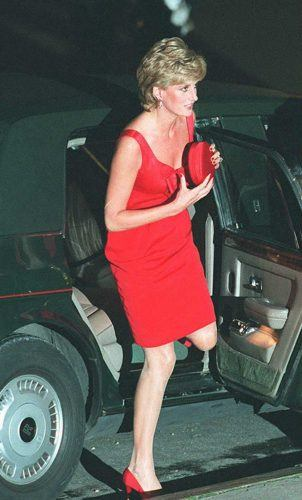 Princess Diana holding a purse getting out of a car