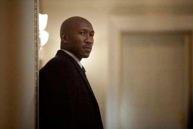 Remy Danton looks straight ahead in a black suit in House of Cards