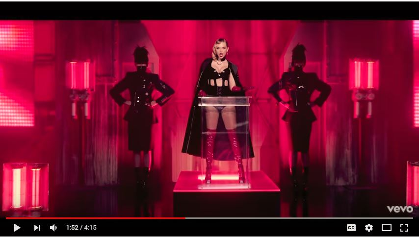 a video still from Look What You Made Me Do with taylor swift in black, surrounded by red
