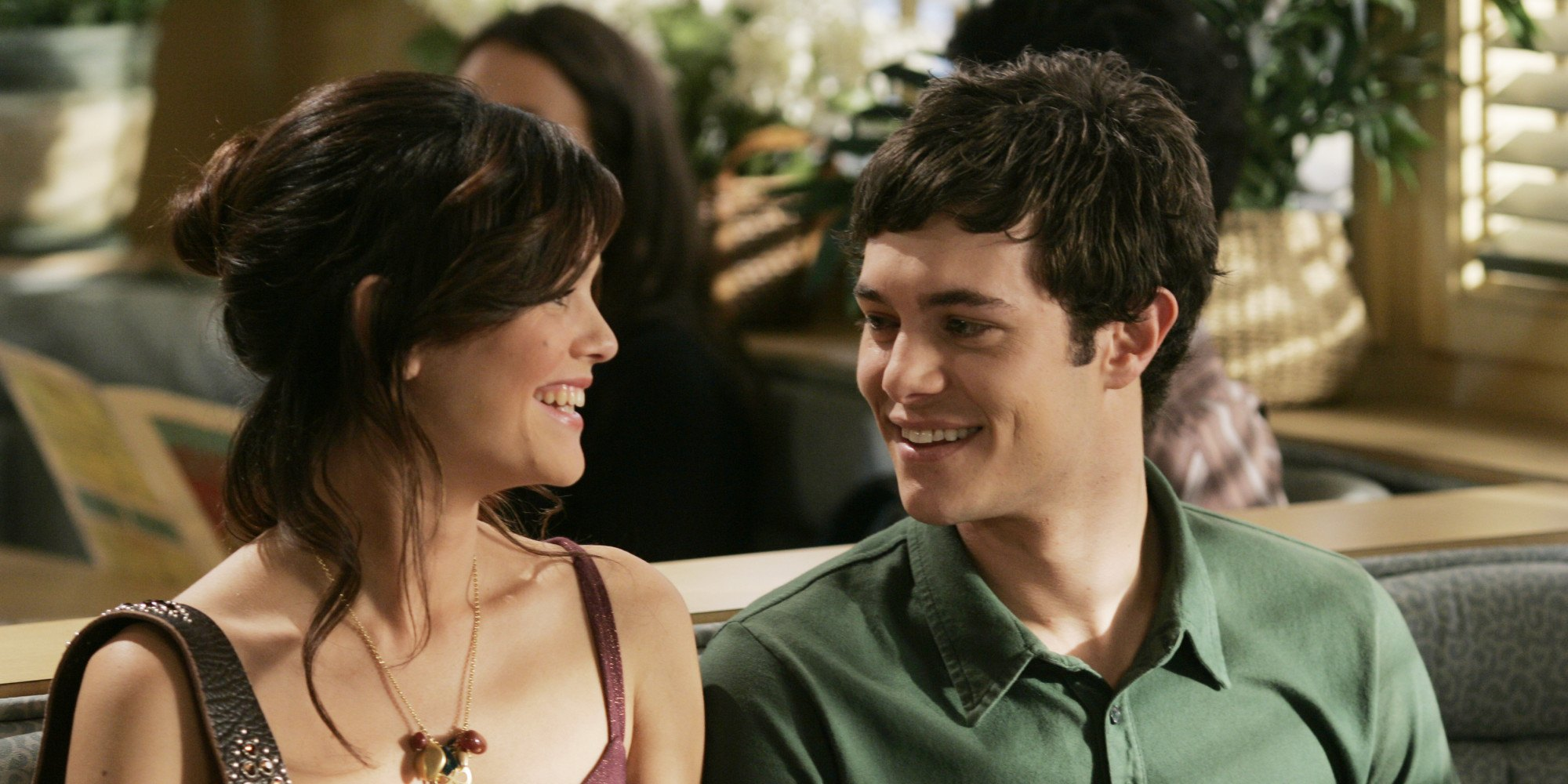 Rachel Bilson as Summer Roberts and Adam Brody as Seth Cohen on The O.C. smiling at each other.