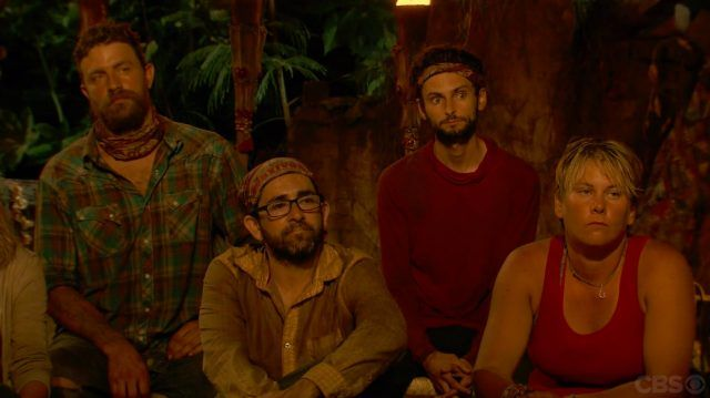 The Survivor contestants react to the votes being read.