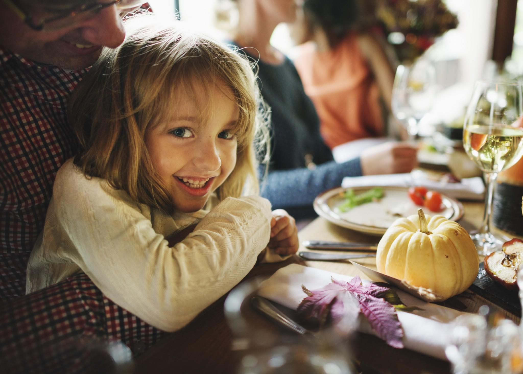 Little Girl Hugging Father Thanksgiving Celebration Concept