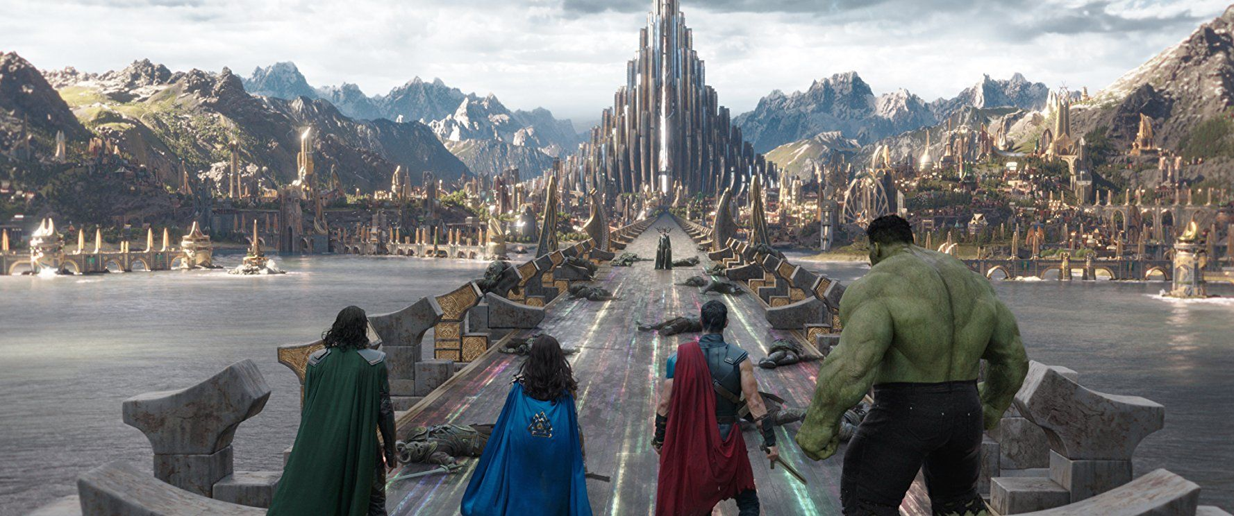 Loki, Valkyrie, Thor, and Hulk face off against Hela, who stands in front of an unguarded Asgard