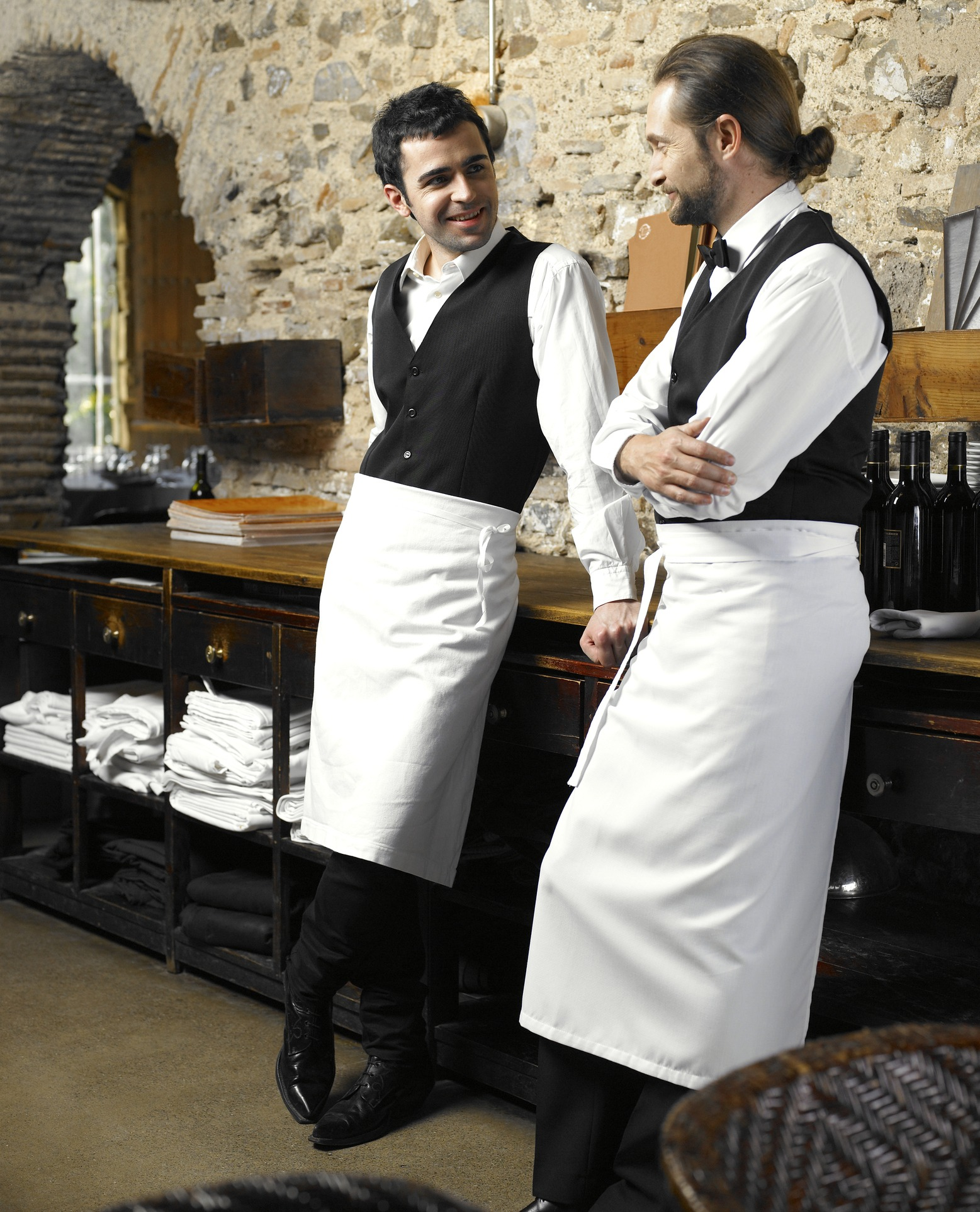 Two waiters talking in restaurant