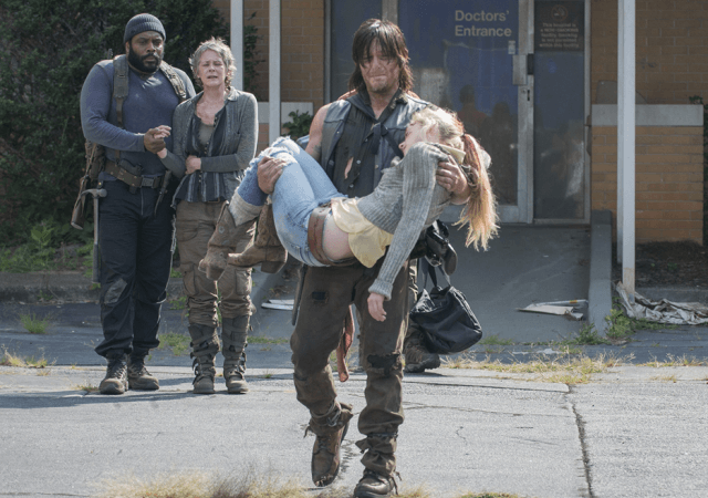 Tyreese and Carol watch sadly as Daryl carries a dead Beth out of the hospital in 'The Walking Dead.'