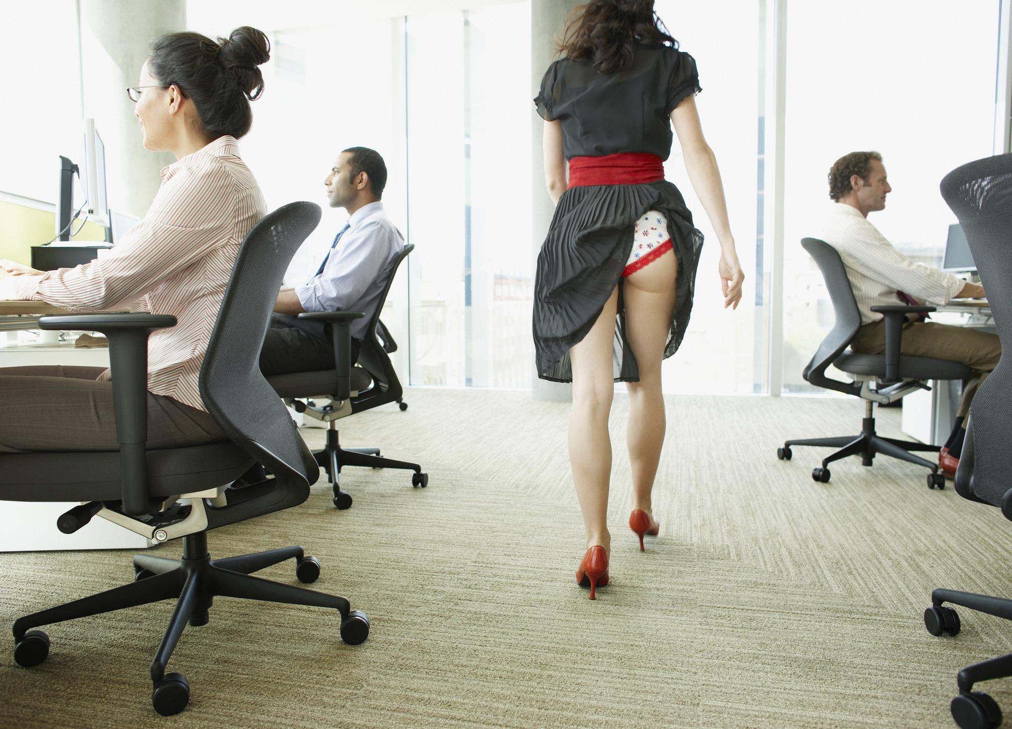 Businesswoman with wardrobe malfuntction