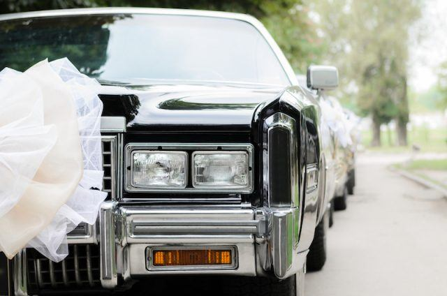 A limo with a white bow.