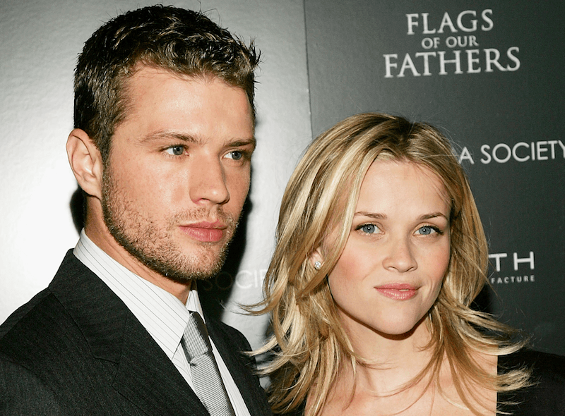 Actress Reese Witherspoon accompanies actor Ryan Phillippe