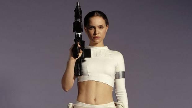 Natalie Portman holds up a weapon