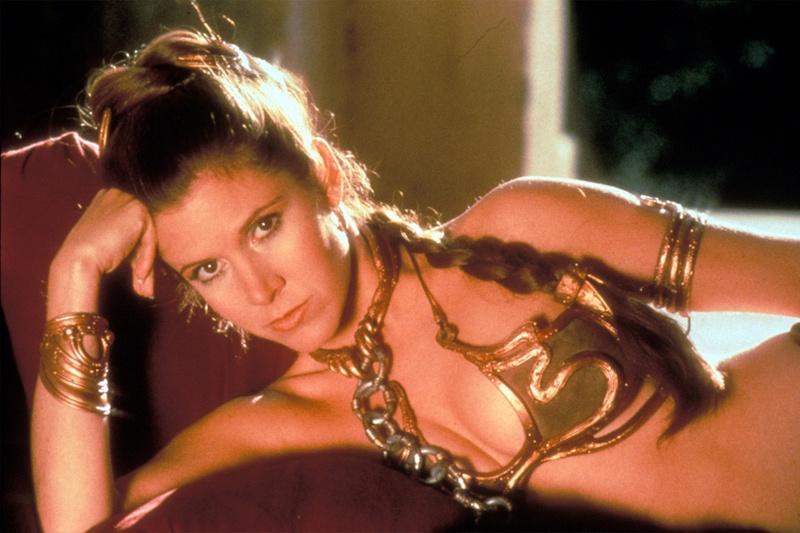 Princess Leia lays in a gold bikini