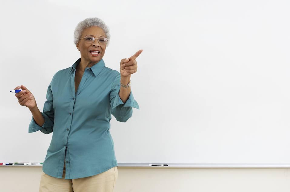 Senior teacher while teaching
