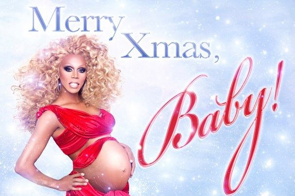 RuPaul in a red dress and fake baby bump