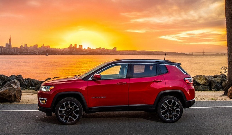 Prfile view of red 2018 Jeep Compass SUV