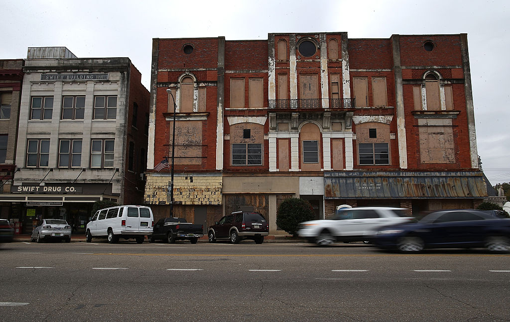 Cars drive by a boarded up building in Selma, Alabama. 50 years after the historic civil rights